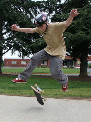 skateboarder performing a 360 flip